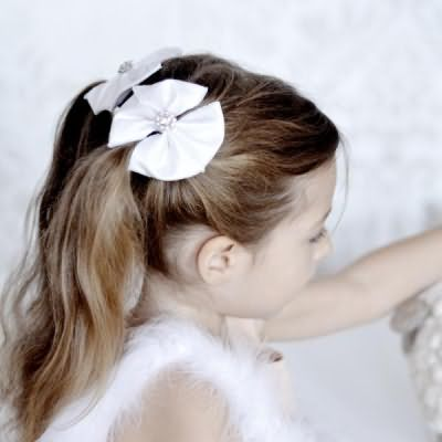 зачіски з бантами для дівчаток