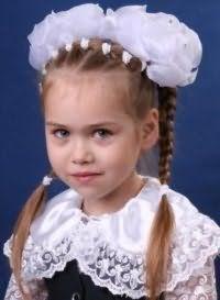 Дитяча зачіска з бантами